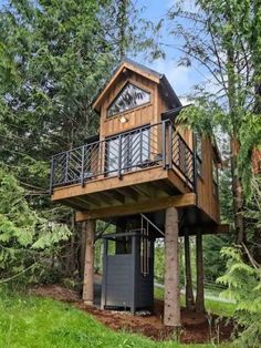 This 160 sq. ft. elevated treehouse has a small kitchen with basic cooking amenities; a bathroom with a flush toilet; a loft bedroom with two skylights; and necessary storage space. Building A Treehouse, Destinations, Cabin In The Woods, Container Design, Compact Living, Cozy Cabin, Log Homes, Tiny Homes, Estate Homes