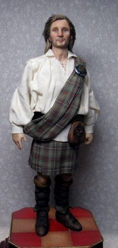 Incredible 1:12th scale miniature likeness of Rob Roy MacGregor (aka Liam Neeson) ... by doll artist Sharon Cariola