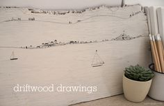 diy art - rough wood with simple drawing. love the cute little stacked houses.