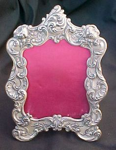 This is a very nice vintage sterling silver picture frame. The frame was produced by Gorham with a product number of 321. The frame is a pretty Art Nouveau scroll and floral repousse design. The finish of the sterling is antiqued. The frame is a desk or table top frame with an easel style back to hold the frame up. The frame is missing its glass face, but could easily be replaced. The frame weighs 43 grams in sterling silver.   | eBay