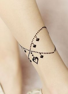 Ah! That's beautiful! I don't even like calf or ankle tattoos but this is pretty.