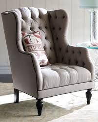 Tufted wing back chair in taupe