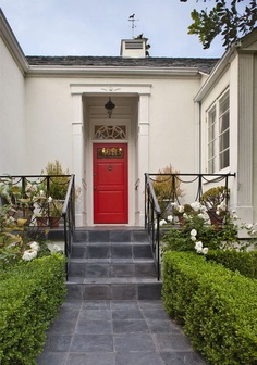 traditional entry by Jeneration Interiors  Red makes its first and only appearance in the front entrance, drawing the eyes — and visitors — in.    Door paint: Vermillon, Benjamin Moore