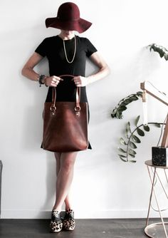 This classic leather tote has an added edge as you can see on the close up pictures. The blanket stitched seams are subtle yet eye catching. The