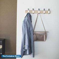 This Japanese-designed wall rack includes five movable hooks so you can customize the look and the capacity. Slide hooks off and on. Reposition them as needed. Since items can hang from the top and bottom of each hook, there's room for coats, jackets, caps, umbrellas, handbags, leashes and more. A natural addition to an entryway, this sleek wall-mounted coat rack can easily double as an accessory organizer for closets.