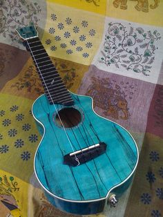 Ukulele turquoise.....someone should teach me how to play this.......Lindsey........