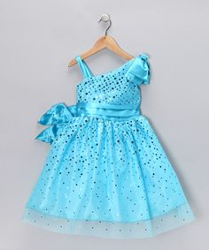 Much like living in a fairy tale, this dress turns every little girl into the perfect princess with layers of tulle and an embellished shoulder. Its sprinkles of sequins combine with a zippered back to capture all the grace that's associated with happily ever after. 100% polyesterDry cleanMade in the USA