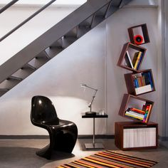 This has to be the coolest bookcase I have ever, ever seen!  I am lusting after it.  I truly think I need it.