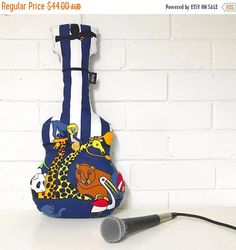 A personal favourite from my Etsy shop https://www.etsy.com/au/listing/524524808/guitar-pillow-kids-pillow-animal-pillow