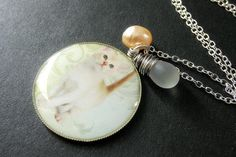 Cat Necklace. White Kitten Necklace with Frosted Teardrop and Peach Fresh Water Pearl. Handmade Jewelry. by StumblingOnSainthood from Stumbling On Sainthood. Find it now at http://ift.tt/2lx475i!