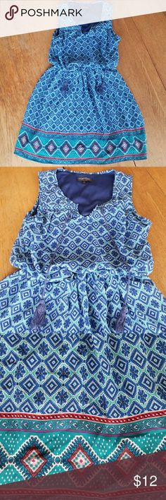 Dress A beautiful blue patterned dress that is a size small in juniors and is wonderful to wear for casual day to day things. Love Reign Dresses
