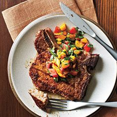 Pork Chops with Caribbean Rub and Mango Salsa - the colors of the mango salsa are amazing! One reviewer mentioned serving this with a black bean and rice salad and roasted sweet potatoes....yum!