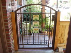 Here's a custom Craftsman style iron garden gate that incorporates Motawi tile.