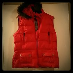 Orange faux fur lined down vest! Orange vest with fax fur around hood! Down filled vest with flannel plaid lined inside! Super warm and cozy! Never worn! metro Jackets & Coats Vests