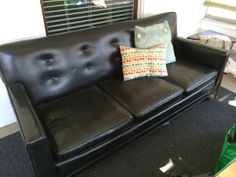 Anitque black leather couch $250