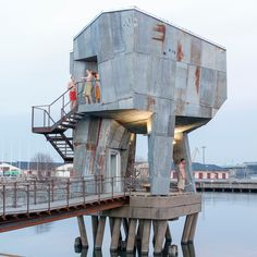 Local residents worked with Berlin-based studio Raumlabor to build the Gothenburg Public Sauna. A wooden bridge projects out in to a harbour to link the sauna on stilts, which is clad in sheets of rusty corrugated metal. German Architecture, Modern Architecture, Temporary Architecture, Concept Architecture, Scandinavian Saunas, Building A Sauna, Green Building, Sunken Hot Tub, Lebbeus Woods