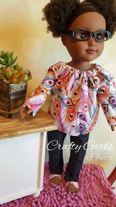 18 inch doll outfit includes skinny jeans with stitched faux pockets, sandals and adorable peasant top. Fits AG