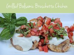 Grilled Balsamic Bruschetta Chicken | Guests will think you slaved away all day on this amazing dish, but little do they know, it's a cinch to make! Pin now, make NOW! | BitznGiggles.com #grilled, #chicken, #basil, #tomatoes, #mozzarella, #balsamic