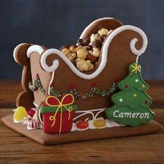 Our exclusive gingerbread sleigh is replete with cheerful peppermint candies, gummies, and sprinkles and takes this iconic delight to a new level. Have it personalized wi Gingerbread House Designs, Christmas Gingerbread House, Christmas Sweets, Christmas Cooking, Noel Christmas, Christmas Goodies, Christmas Candy, Christmas Crafts, Gingerbread Houses