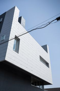 Office and apartment building in Japan featuring a steel-plated facade.