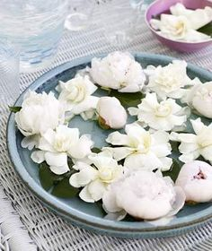 Floating peonies and gardenias make a pretty centerpiece. Just pour water into a large serving platter, and trim the stems off each flower.   When the weather warms and your parties move outdoors, try these simple ideas.