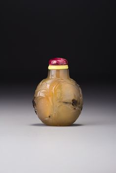 AN INSCRIBED CHALCEDONY 'ROCKY LANDSCAPE' SNUFF BOTTLE SUZHOU, SCHOOL OF ZHITING, QING DYNASTY, 18TH / 19TH CENTURY