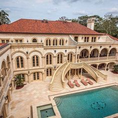 Absolutely breathtaking coral stone palatial estate. The attention to detail and craftsmanship is like no other in Atlanta. This opulent home features 33,000 sq ft of living space, 9 bedrooms, 12 bathrooms, 7 kitchens, 2 gyms, a home theatre and bar, a cigar room, recording studio, 2 hot tubs, 3 outdoor kitchens including a pizza grill, a resort style pool and a few lounge areas. What more could you ask for? | Listed at $15,800,000 by Atlanta Fine Homes