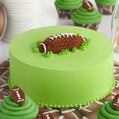 First Down and Fun Football Cake.  Celebrate your team's victory with this oh-so-easy cake. Covered with buttercream icing, the football topper is created using piped stars surrounded by pull-out grass turf.