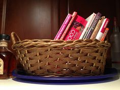 Simple Organization - put your cookbooks in a cute basket on top of your fridge and free up your cabinet!