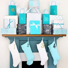 Simple Christmas mantel using actual gifts @ShabbyCreek