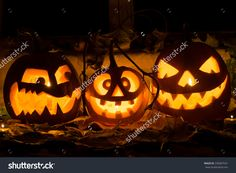 Photo Of Three Pumpkins For Halloween. Embittered, Cheerful With A Smile And Evil Pumpkin Against Autumn Leaves And Candles - 330007541 : Shutterstock