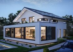 Modern design house with pitched roof – House Concept-M 210 Bien Zenker – Detached house build with bay window Installation floor-to-ceiling windows Balcony – HausbauDirekt. House Extension Plans, House Extension Design, Bungalow Extensions, House Extensions, Casa Atrium, Living Haus, Bungalow Renovation, Modern Bungalow, House Roof