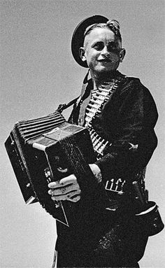Soviet marine playing the accordion:   We must fight; but we must still make music,  For life would have no joy and death no meaning, without art.