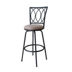 """Whether you're enjoying a weekday morning meal or spending your Sunday scrap-booking, you'll be sitting in style at the kitchen island with this bar stool. Founded atop four gently slanted legs connected by a round bar, its frame is crafted of metal and features a dark finish. Its frame is adjustable with extensions included so you can change the height from 37"""" to 43"""". Up top, the back offers an intricate openwork design, while the circular swivel seat is wrapped in solid-h..."""