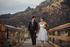 Elena Gallegos Wedding. Mountain Backdrop. Holding Hands.. Creative Wedding Photography. Candid Moments. Bride and Groom.