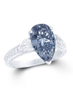 Graff 3.15ct Fancy Dark Greyish Blue diamond engagement ring with a white diamond band.