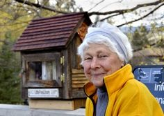 JOHN CREPEAU/Missoulian  Lela Autio sits in front of her newly opened Little Free Library Charter No. 0970 at Linden Street and Duncan Drive in Missoula on Tuesday morning. Read more: http://missoulian.com/news/local/little-free-library-opens-in-missoula-s-rattlesnake-valley/article_203e0bb6-8900-11e1-9e44-0019bb2963f4.html#ixzz1sOg5XwLq