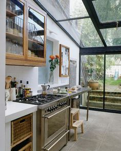 love the outdoor access and leggy stainless counter. and the glass ceiling!