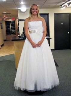 Season 7 Featured Dresses, Part 8. Hilary. Dress info: Tara Keely. Sherbet. Lace and taffeta. Ballgown. Strapless with traditional neckline. Scalloped edge along neckline. Lace throughout bodice. Ribbon belt with floral and feather accent. Full, A-line skirt. $2,730.00. #Weddings #SYTTD