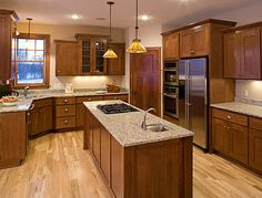 CliqStudios Oak Saddle kitchen cabinets in the Rockford style