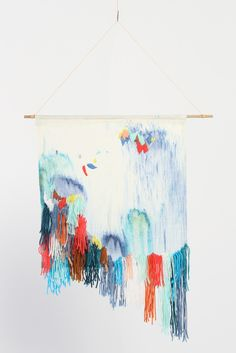 Textile wall hanging created by Bendigo-based artist Andrea Shaw exclusively for Dagmar Rousset. Organic Cotton/Hemp has been hand dyed to create an expressive and organic surface design, then embellished using varying embroidery techniques with a colourful palette of yarn remnants.