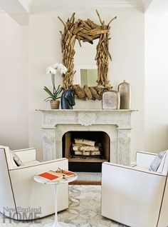 Driftwood mirror above fireplace.