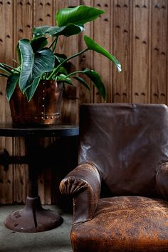 The textures of our showroom. Wood paneling, vintage leather, metal touches and lots of studs. http://bdantiques.com/