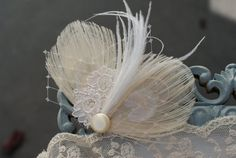 Items similar to Peacock Feather Bridal Fascinator - Bridal Hair Piece - Feather Fascinator Ivory - Peacock Hair Clip with Lace PURE - vintage modern pretty on Etsy