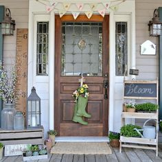 It's porch season! Creating an eye-catching display can be effortless—just gather finds such as shrubs, succulents, and chalkboard signs. Use them to flank your front door and complete the display with old rain boots filled with flowers.