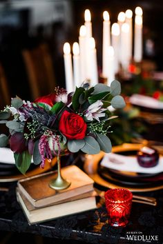 We love the vibrant, lush greenery, gold decor accents, paired with brilliant touches of red. | Photography by: Caroline Ross Photography Studio | WedLuxe Magazine | #wedding #luxury #weddinginspiration #tabledecor