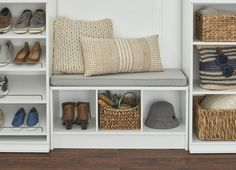 A built-in bench with storage makes for an inviting and functional entryway. #Entryway #Mudroom #HomeOrganization Bench With Shoe Storage, Built In Bench, Flat Organization, Birch Lane Furniture, Laundry In Bathroom, Wood Laminate, Hallway Decorating, Seat Cushions, Entryway