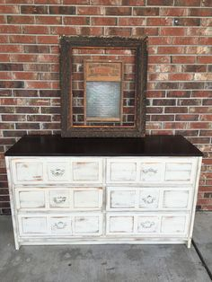 I'm loving this rustic dresser. It is painted cream and has a brown top. All 6 drawers are lined and work great. The old picture frame and washboard top it off just right.