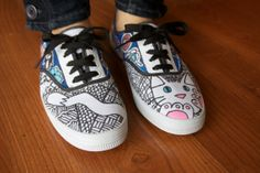 Vans hand painted with a white cat with blue eyes and pink paw pads!