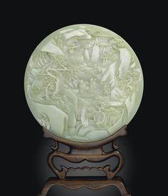 A PALE CELADON JADE CIRCULAR TABLE SCREEN -  QIANLONG PERIOD (1736-1795).